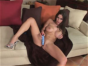 Rachel Roxx relieves bare on the couch opening up her hairless pussy