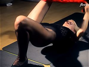 Fit Elena flashes off her gymnast bare bod