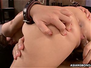asian beauty receives a harsh cooter and bootie pounding
