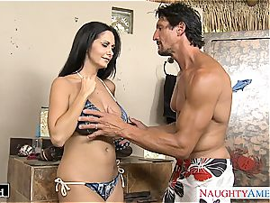 Ava Addams places his pink cigar between her fat bra-stuffers