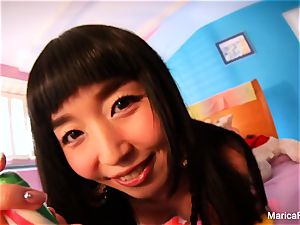 japanese star Marica Hase plays with candy bone