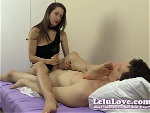 She masturbates his fuckpole while caressing her soles and feet