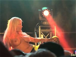 huge-titted cougar lapdance on stage