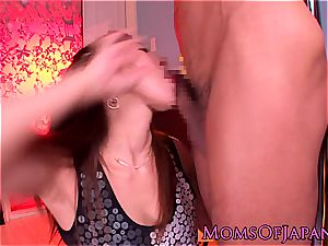 asian mama grinds her vag on his face