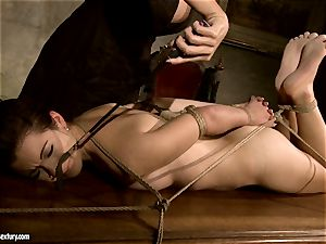 Mandy Bright bind a fabulous nude stunner on the table